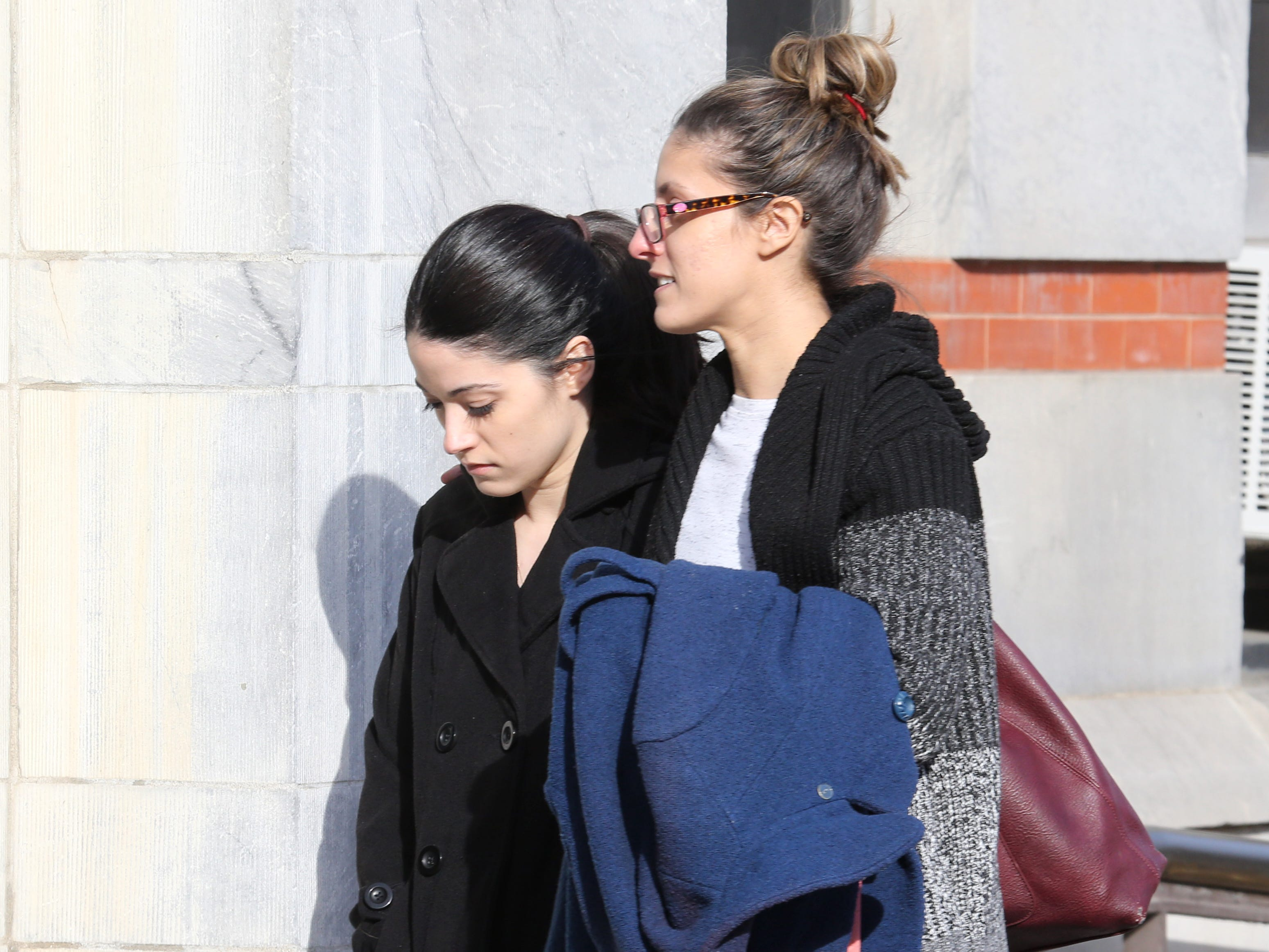 Nicole Addimando, at left, arrives at Dutchess County Court accompanied by her sister, Michelle Horton in the City of Poughkeepsie on January 17, 2019.