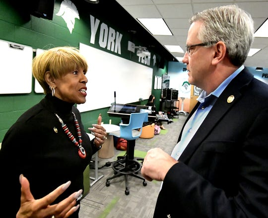 State Representatives Carol Hill-Evans and Mike Jones talk after a press conference at the York County School of Technology Thursday, Jan. 17, 2019. PA Schools Work, a statewide, bipartisan movement supporting fair public school funding, sponsored the meeting regarding workforce development. Bill Kalina photo