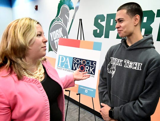 State Representative Kate Klunk talks with York County School of Technology communication technology senior Charlie Zapata after a press conference at the school Thursday, Jan. 17, 2019. PA Schools Work, a statewide movement supporting fair public school funding, sponsored the meeting regarding workforce development. Bill Kalina photo