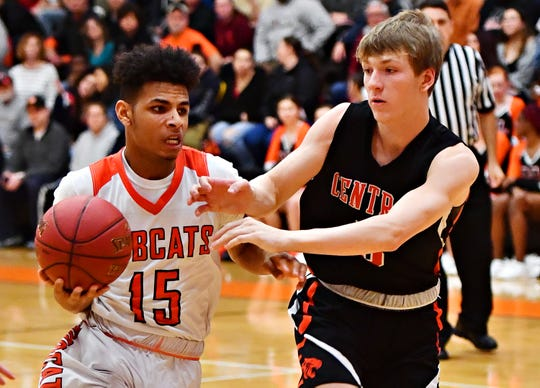 Northeastern's Maurice Capo, left, looks to get past Central York's Braden Richard during boys basketball action at Northeastern Senior High School in Manchester, Wednesday, Jan. 16, 2019. Central York would win the game 72-61. Dawn J. Sagert photo