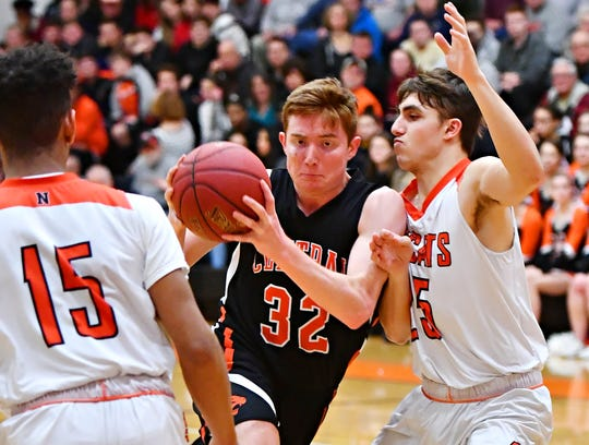 Central York's Gabe Guidinger, center, seen here in a file photo, had 19 points on Friday night in the Panthers' big win at New Oxford.
