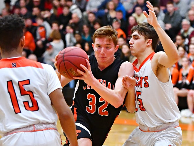 Central York's Gabe Guidinger, left, works to get past Northeastern's Brandon Michael during boys basketball action at Northeastern Senior High School in Manchester, Wednesday, Jan. 16, 2019. Central York would win the game 72-61. Dawn J. Sagert photo