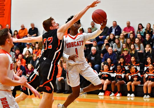 Central York's Gabe Guidinger, left, works to stop Northeastern's Quay Mulbah during boys basketball action at Northeastern Senior High School in Manchester, Wednesday, Jan. 16, 2019. Central York would win the game 72-61. Dawn J. Sagert photo