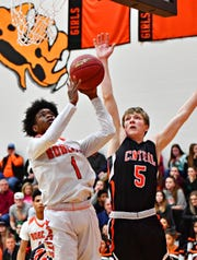 Northeastern's Quay Mulbah, left, take the ball the basket while Central York's Braden Richard defends during boys basketball action at Northeastern Senior High School in Manchester, Wednesday, Jan. 16, 2019. Central York would win the game 72-61. Dawn J. Sagert photo
