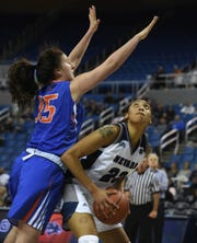 Nevada's Terae Briggs looks to shoot past the defense of Boise Sate's Tess Amundsen  during Wedndesday's game.