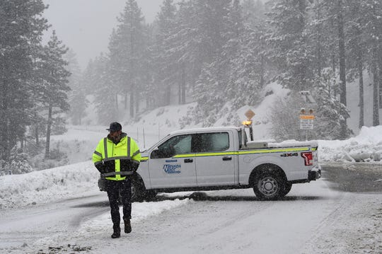 A Nevada Dept. of Transportation vehicle is seen closing the Mt. Rose Highway near Reno on Jan. 17, 2019. The closure is due to snowy conditions and avalanche control work at higher elevation.