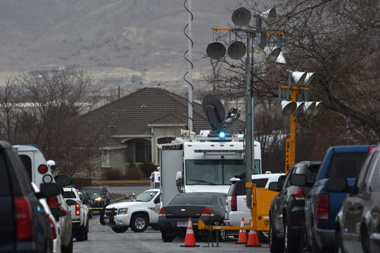 Authorities investigate the scene where two bodies were found in a home near the intersection of La Guardia Lane and Valley Springs Road in South Reno on Jan. 17, 2019.