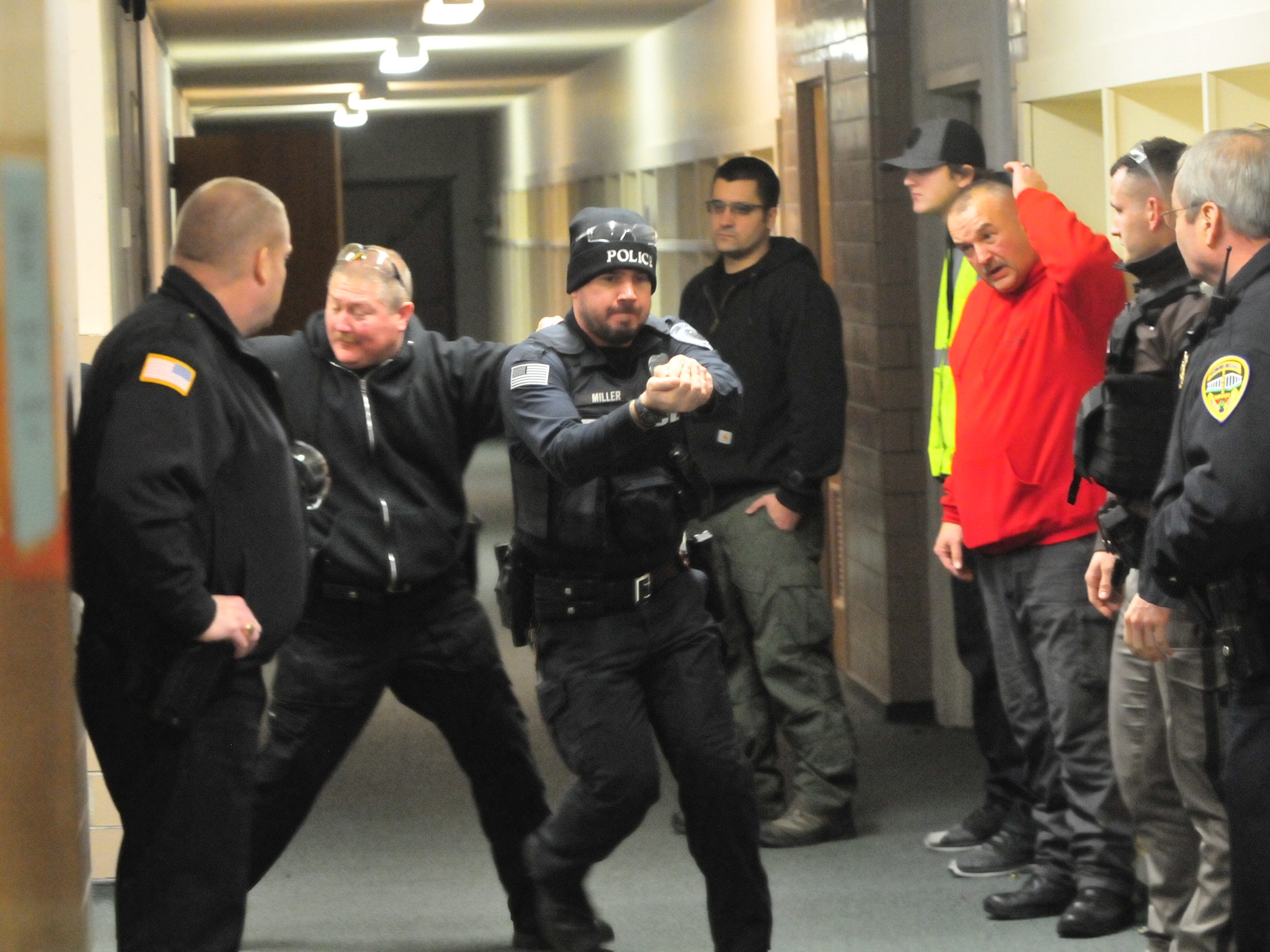Participating officers rehearse a technique during active-shooter training Wednesday.