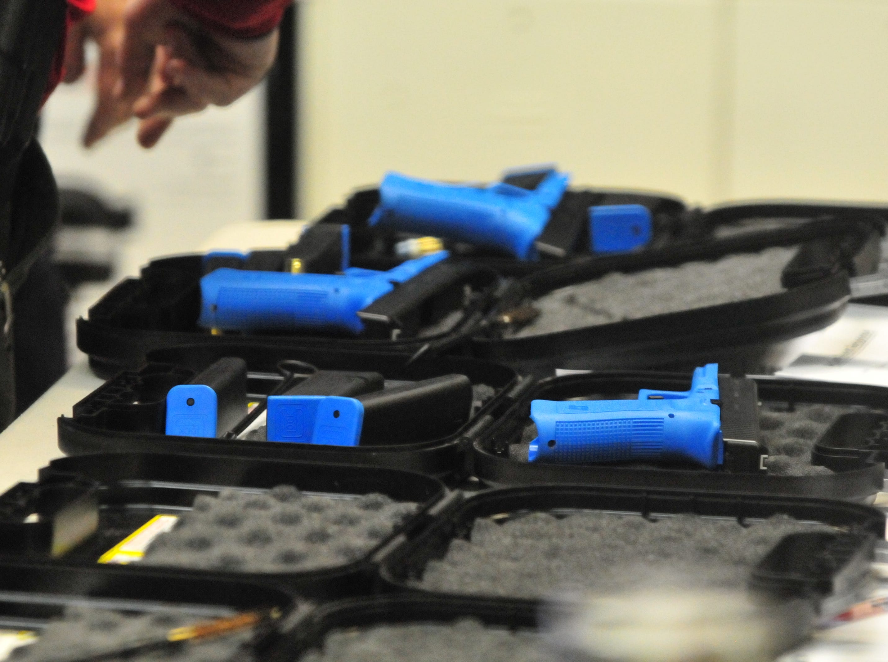 Simulation weapons are ready for officers to use during Wednesday's active-shooter training.