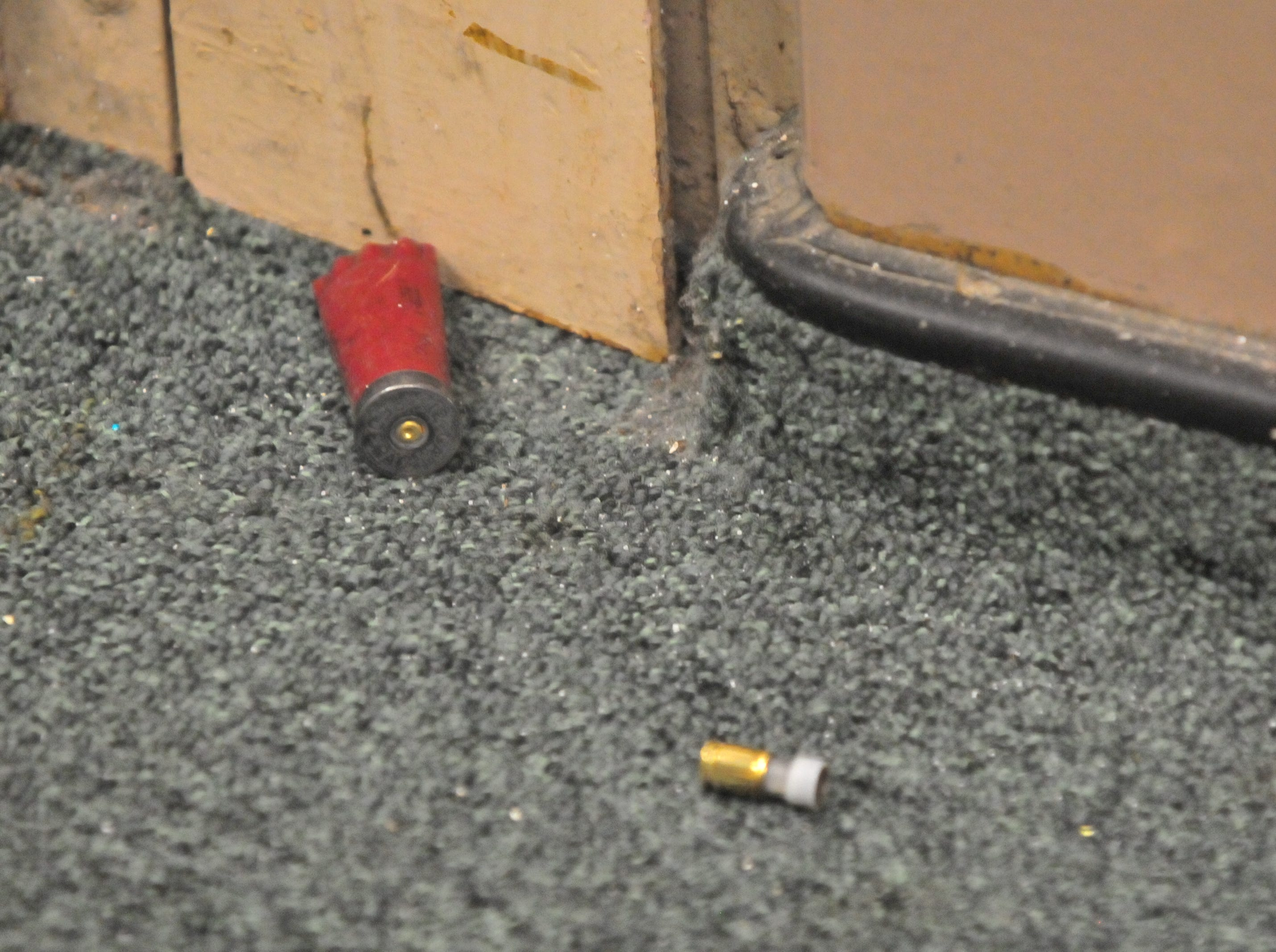 Spent shell casings litter the floor of a hallway inside the former Pleasant View school building.