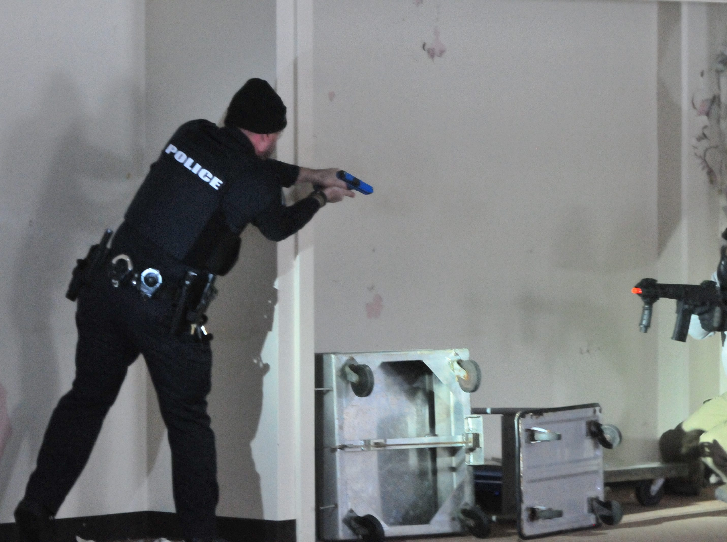 "An officer exchanges fire with a ""suspect"" during an active-shooter training scenario Wednesday."