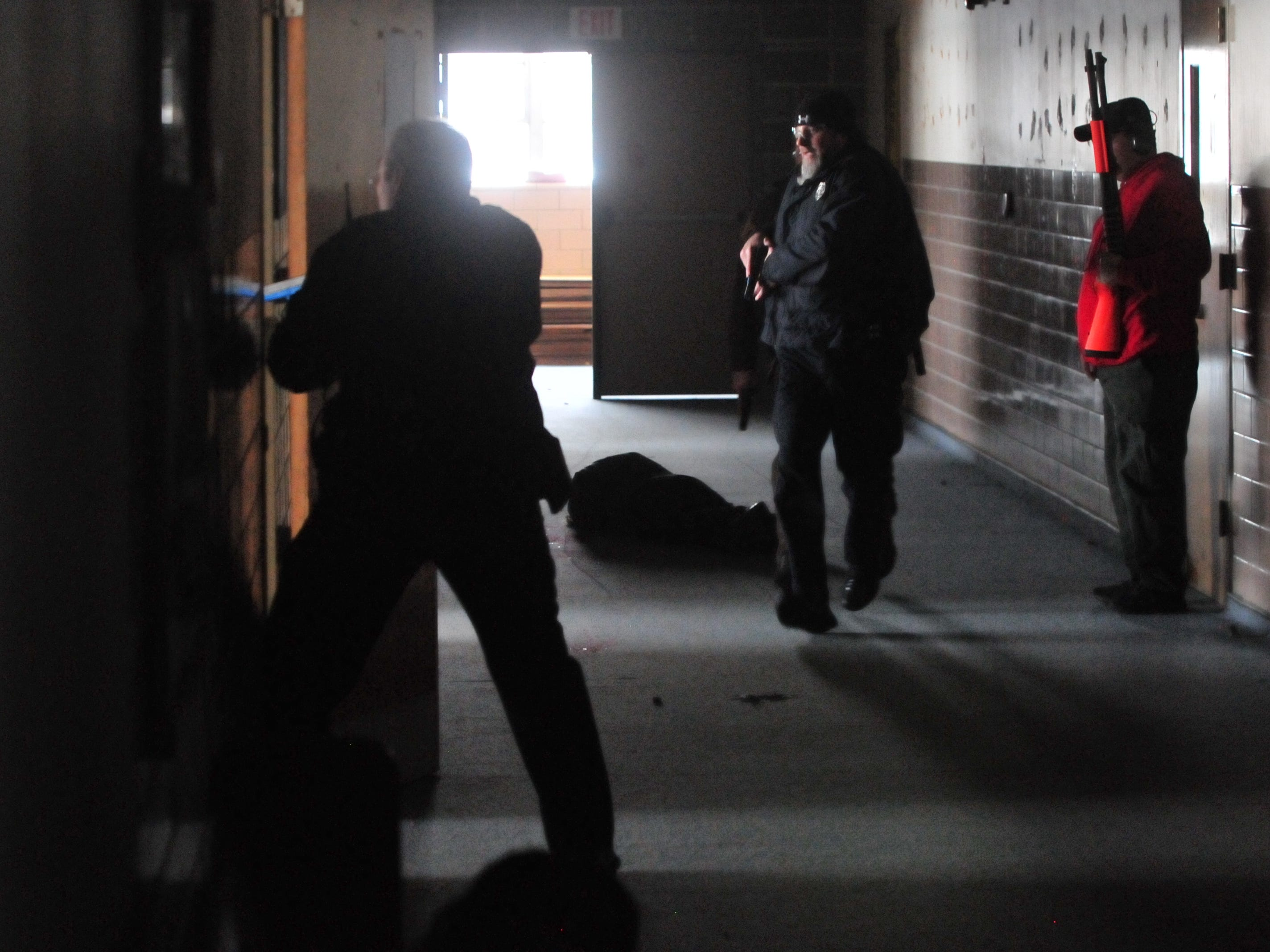 "Officers approach a room as they search for ""suspects"" during an active-shooter training scenario Wednesday inside the former Pleasant View school building."