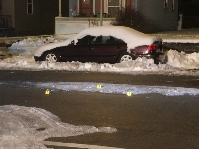 Evidence markers on Lincoln Street at the intersection with North West Second Street designated the location of shell casings.