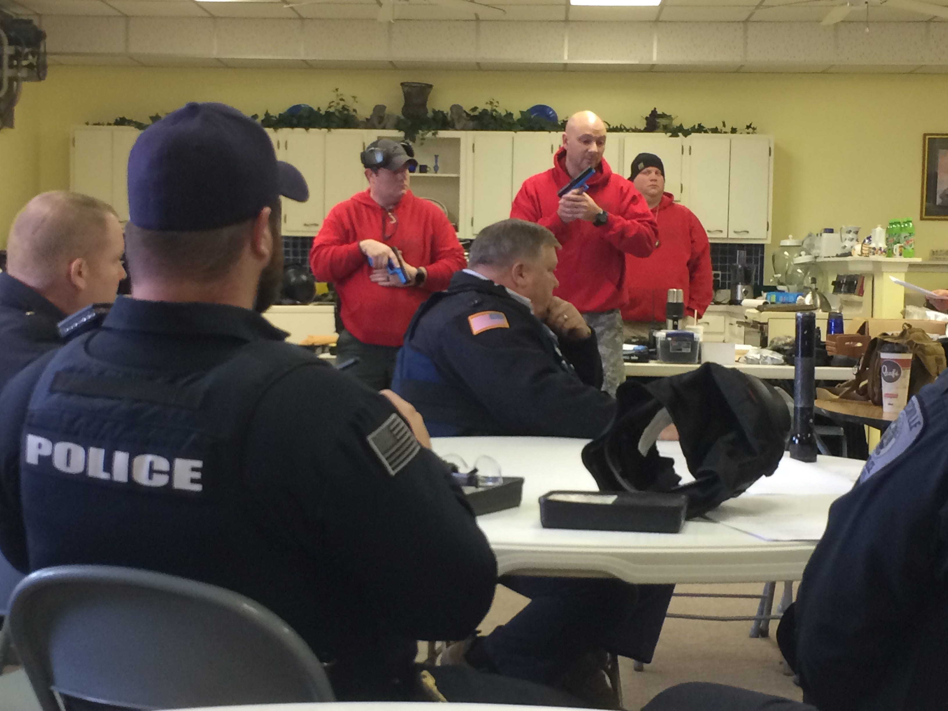 Officer Jordan Tudor (from left), Sgt. Chad Porfidio and Detective Scott Glover, training instructors, demonstrated techniques prior to Wednesday's active-shooter training scenarios.