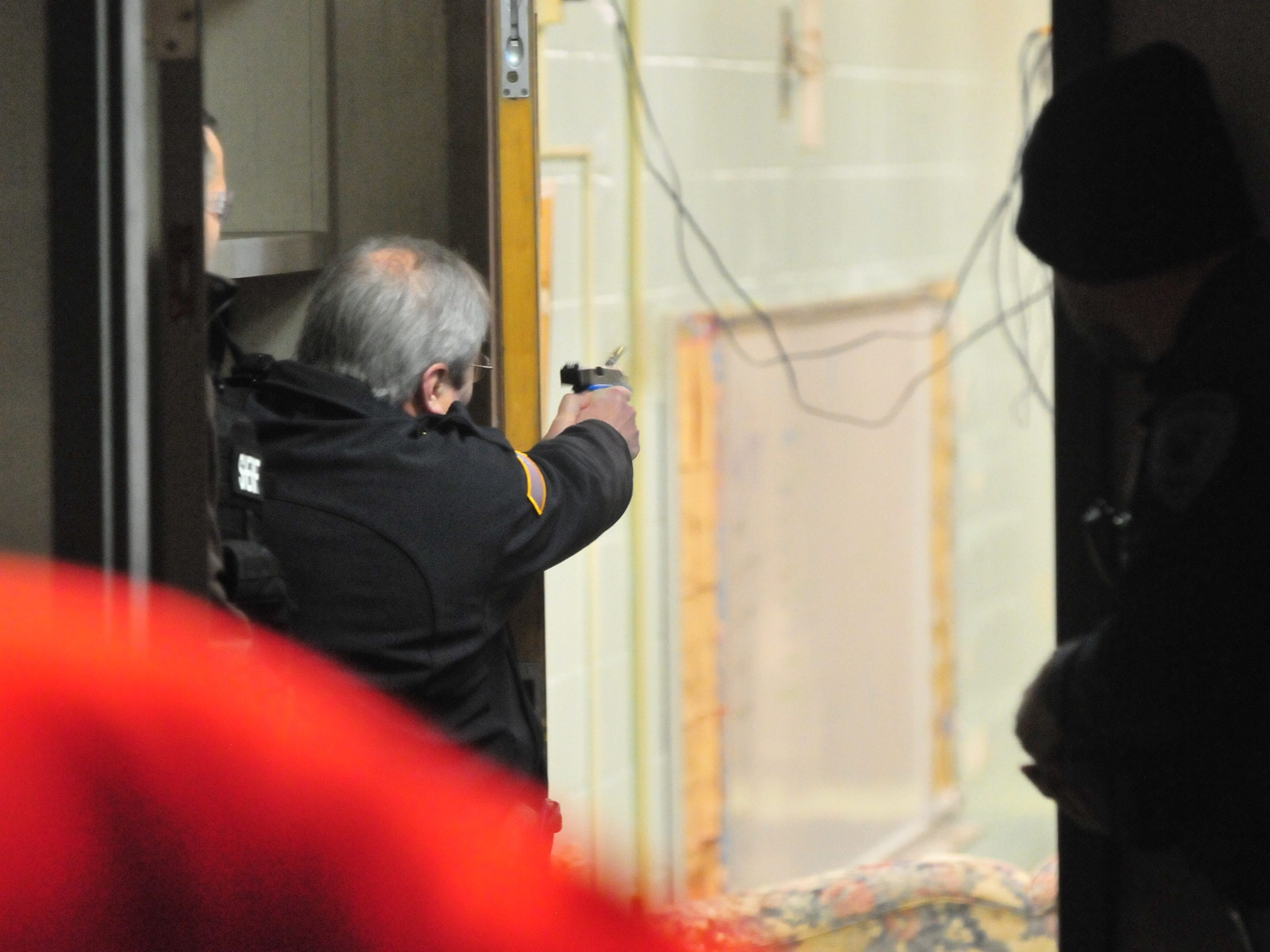 "Richmond Police Department Chief Jim Branum fires his simulation weapon at a ""suspect"" during an active-shooter scenario inside the former Pleasant View school building."