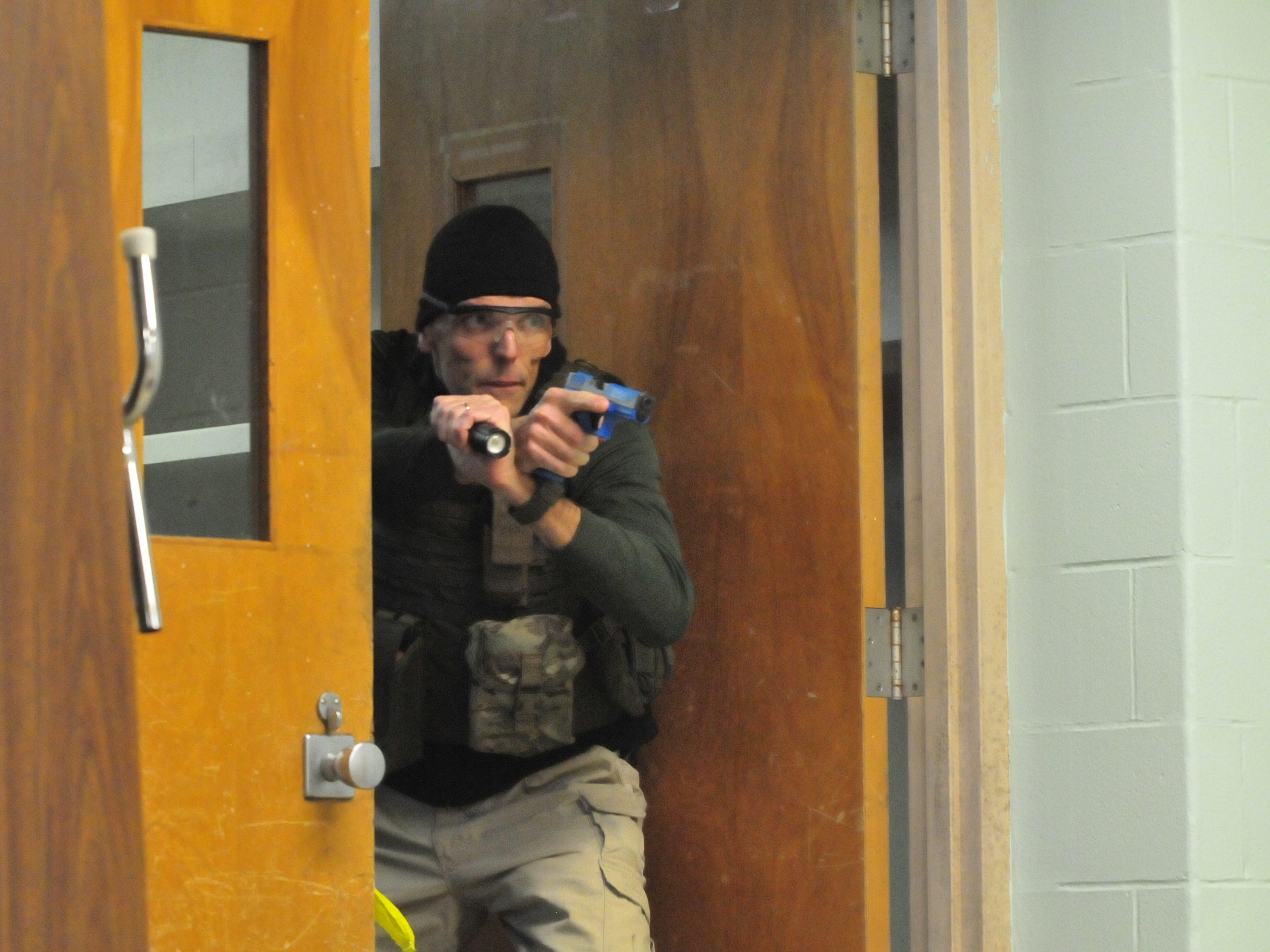 Richmond Police Department Detective Ron Pennington enters a room during an active-shooter scenario inside the former Pleasant View school building.