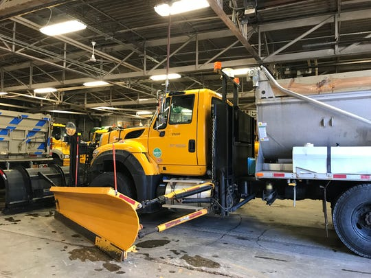 A state DOT plow getting ready for an expected snowstorm