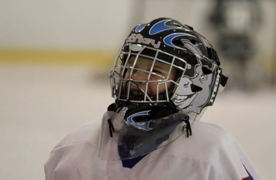 "Rush-Henrietta hockey goalie Cameron Kuzniar, who was gone by ""Donkey"" since birth, is shown at a young age with a helmet themed after the nickname."