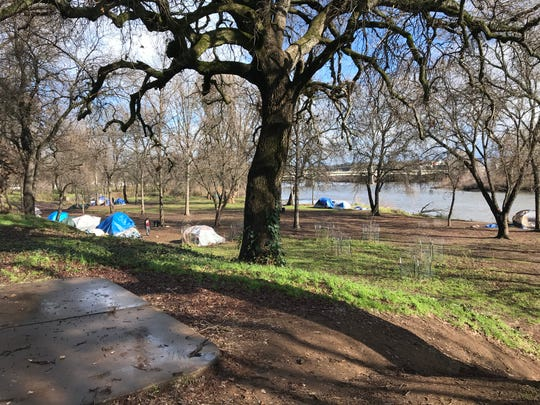 People were living in tents along the Sacramento River near City Hall on Jan. 17, 2019.