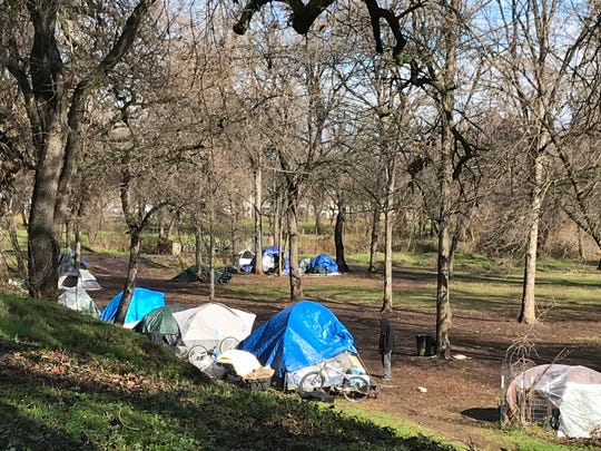 People were living in tents along the bank of the Sacramento River in Redding's Parkview Riverfront in January 2019.