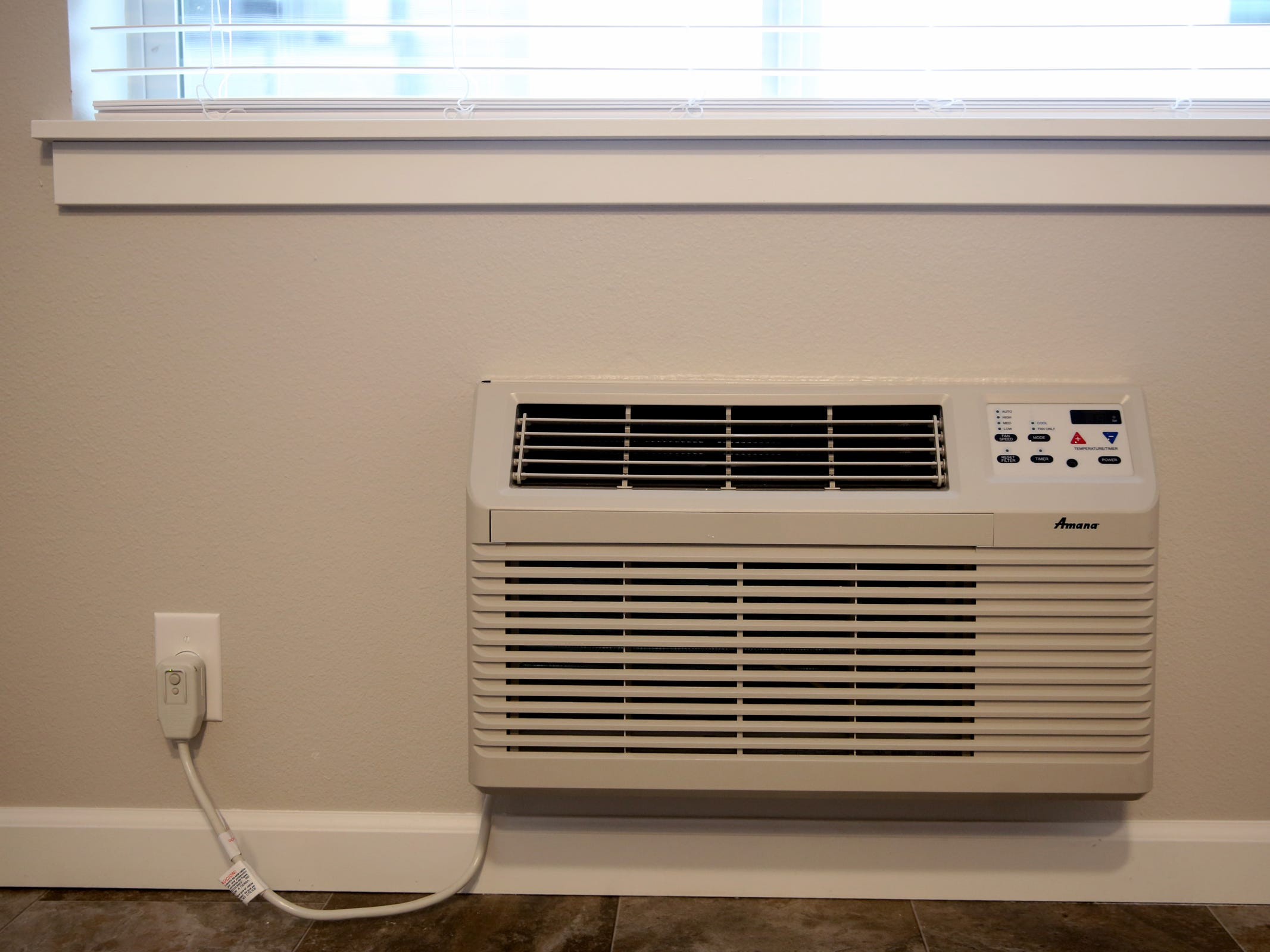 An air conditioning unit at the Cornerstone Apartments in Salem on Wednesday, Jan. 16, 2019. The state is looking to reduce the energy burden for low-income Oregonians, including tenants at Cornerstone, who must live at or less than 60 percent of the area's median household income.