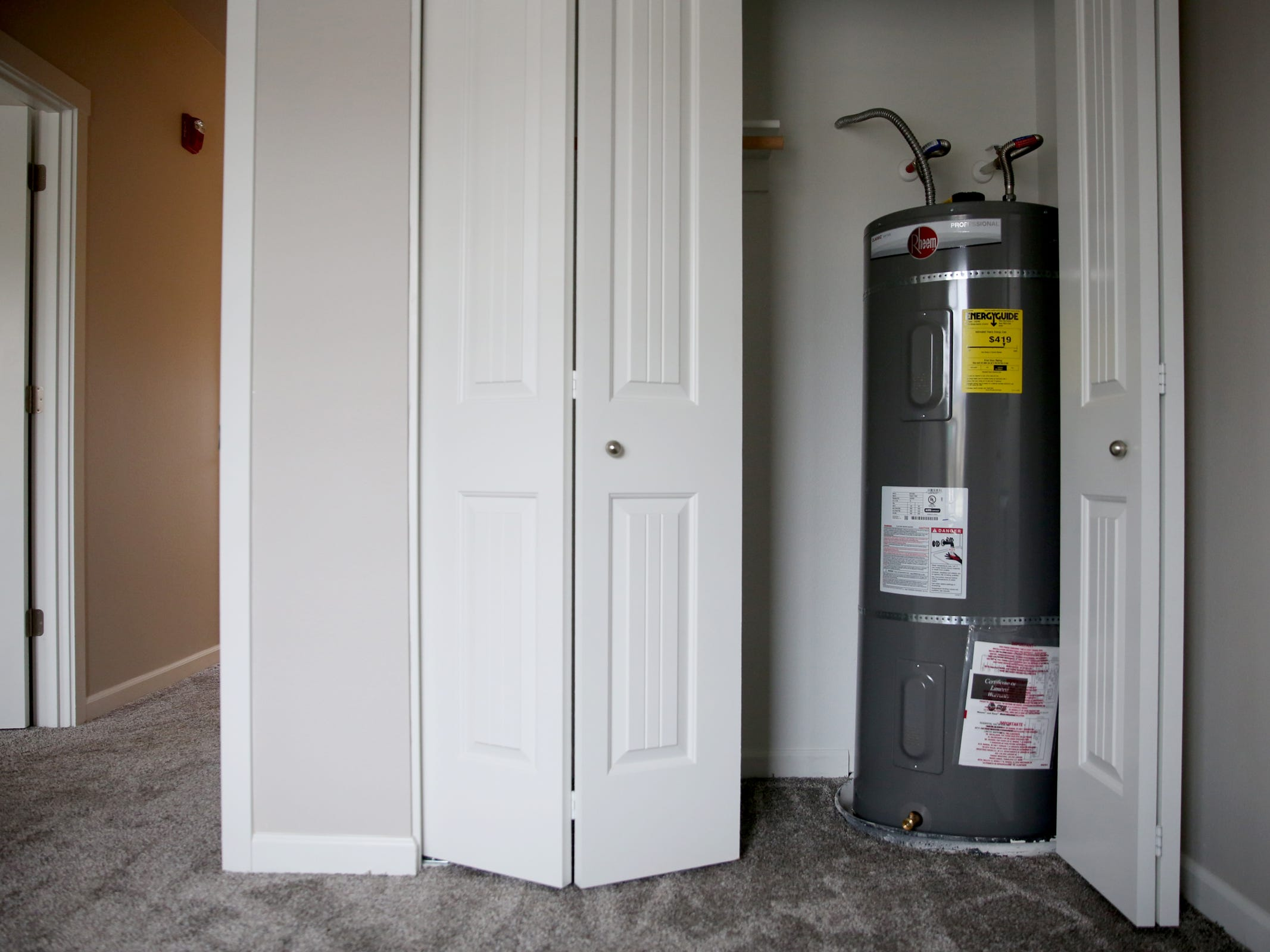A water heater a bedroom closet at the Cornerstone Apartments in Salem on Wednesday, Jan. 16, 2019. The state is looking to reduce the energy burden for low-income Oregonians, including tenants at Cornerstone, who must live at or less than 60 percent of the area's median household income.