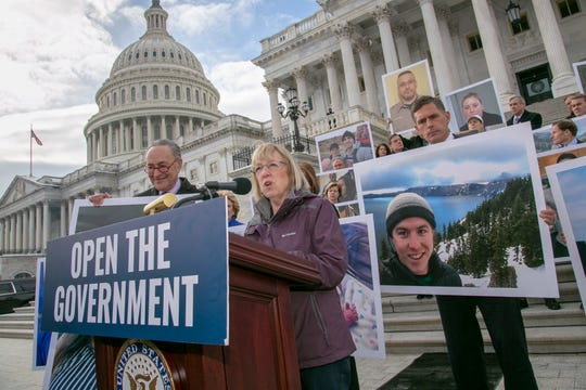 On day 26 of the partial government shutdown, Senate Democrats, led by Senate Minority Leader Chuck Schumer, D-N.Y., and Senate Health, Education, Labor and Pensions ranking member Patty Murray, D-Wash., assemble outside the Capitol holding photographs of their constituents affected by the impasse between Congress and the White House, in Washington, Wednesday, Jan. 16, 2019.