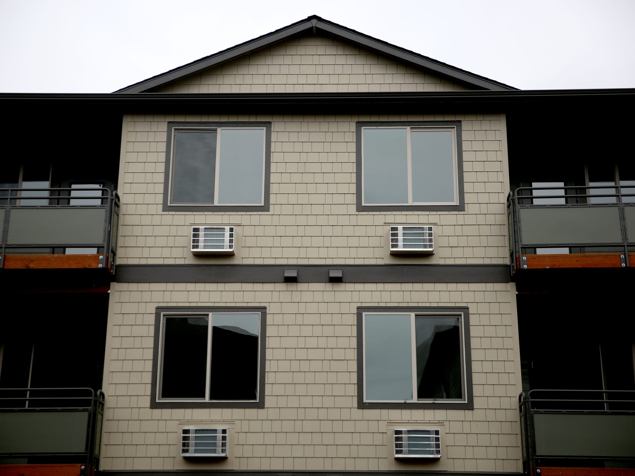 Air conditioning units under apartment windows at the Cornerstone Apartments in Salem on Wednesday, Jan. 16, 2019. The state is looking to reduce the energy burden for low-income Oregonians, including tenants at Cornerstone, who must live at or less than 60 percent of the area's median household income.