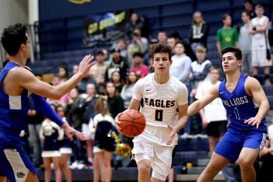 Stayton's Logan Classen (0) moves between Woodburn's RJ Veliz (12) and Trevor Karsseboom (1) in the first half of the Woodburn vs. Stayton boys basketball game at Stayton High School in Stayton on Wednesday, Jan. 16, 2019. Stayton won the game 68-51.
