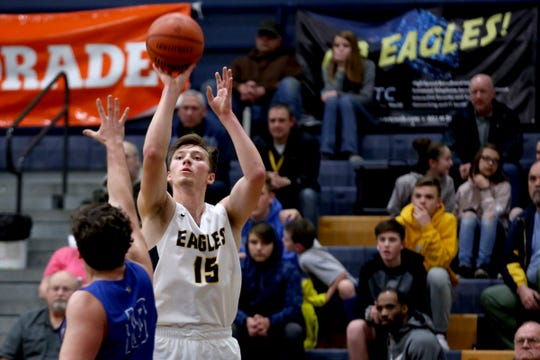 Stayton's Riley Nichol (15) shoots over Woodburn's Ryan Stebner (10) in the first half of the Woodburn vs. Stayton boys basketball game at Stayton High School in Stayton on Wednesday, Jan. 16, 2019. Stayton won the game 68-51.