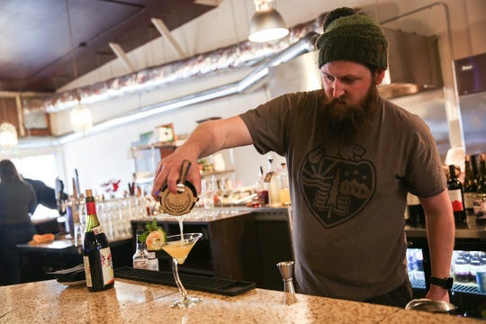 Bartender Kenny Conly makes a drink at The Valkyrie Wine Tavern in Independence on Thursday, Jan. 16 2019.
