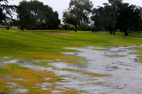 Water from a seasonal creek overflows at the Salinas Fairways Golf Course Wednesday.