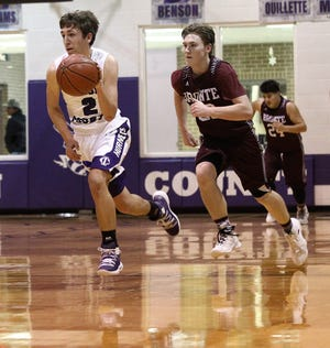 Irion County's Kaden Councilman (2) drives the ball up the court on a fast break while Bronte's Jadan Morgan tries to catch up during District 11-1A boys basketball action Tuesday, Jan. 15, 2019, at Irion County's Estes Gym.