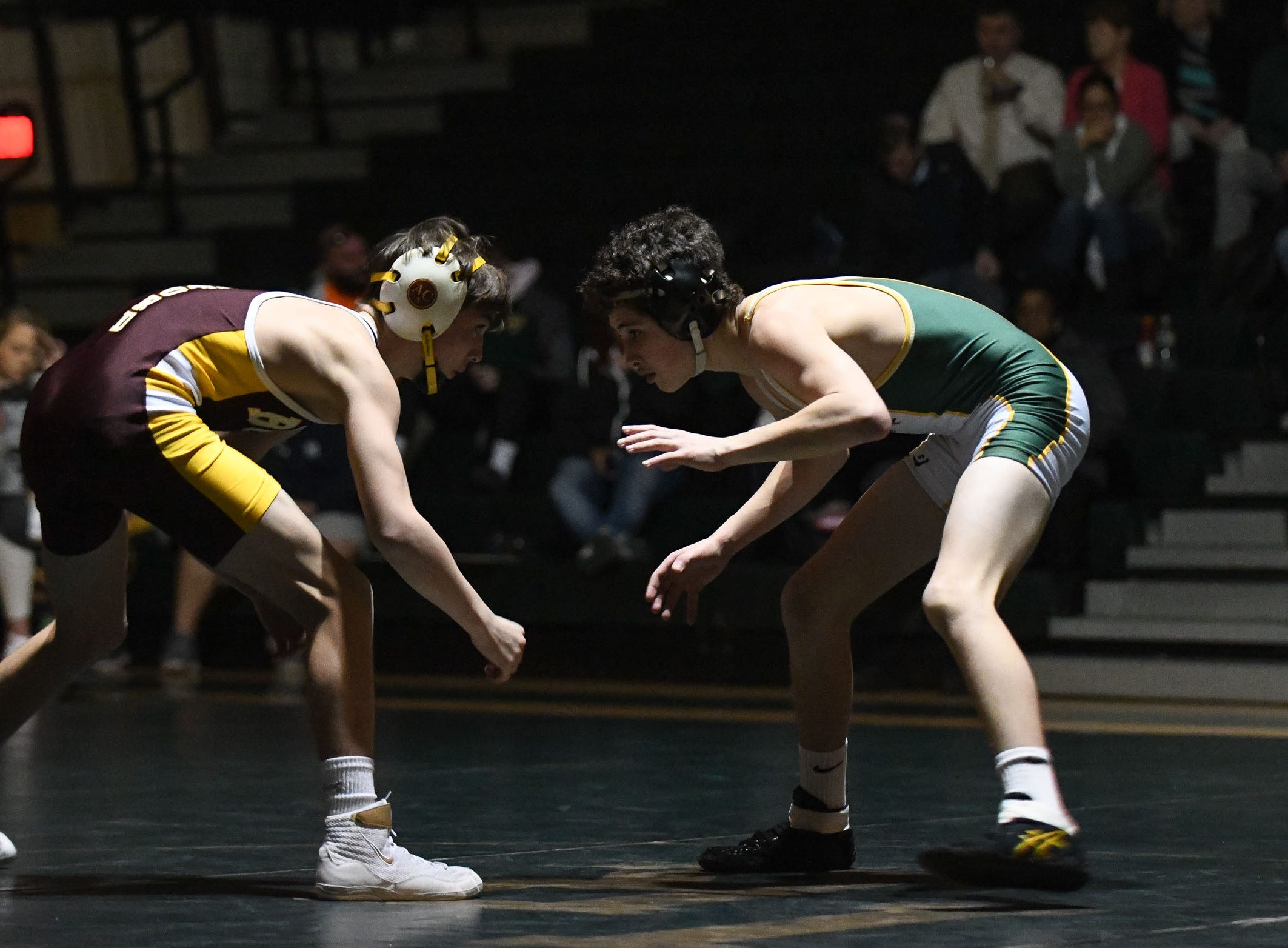 Indian River's Chris Saylor battled Milford's Corey Messick during the 106lb match on Thursday, Jan 17, 2019 in Dagsboro, Del. Milford won the match 53-15.