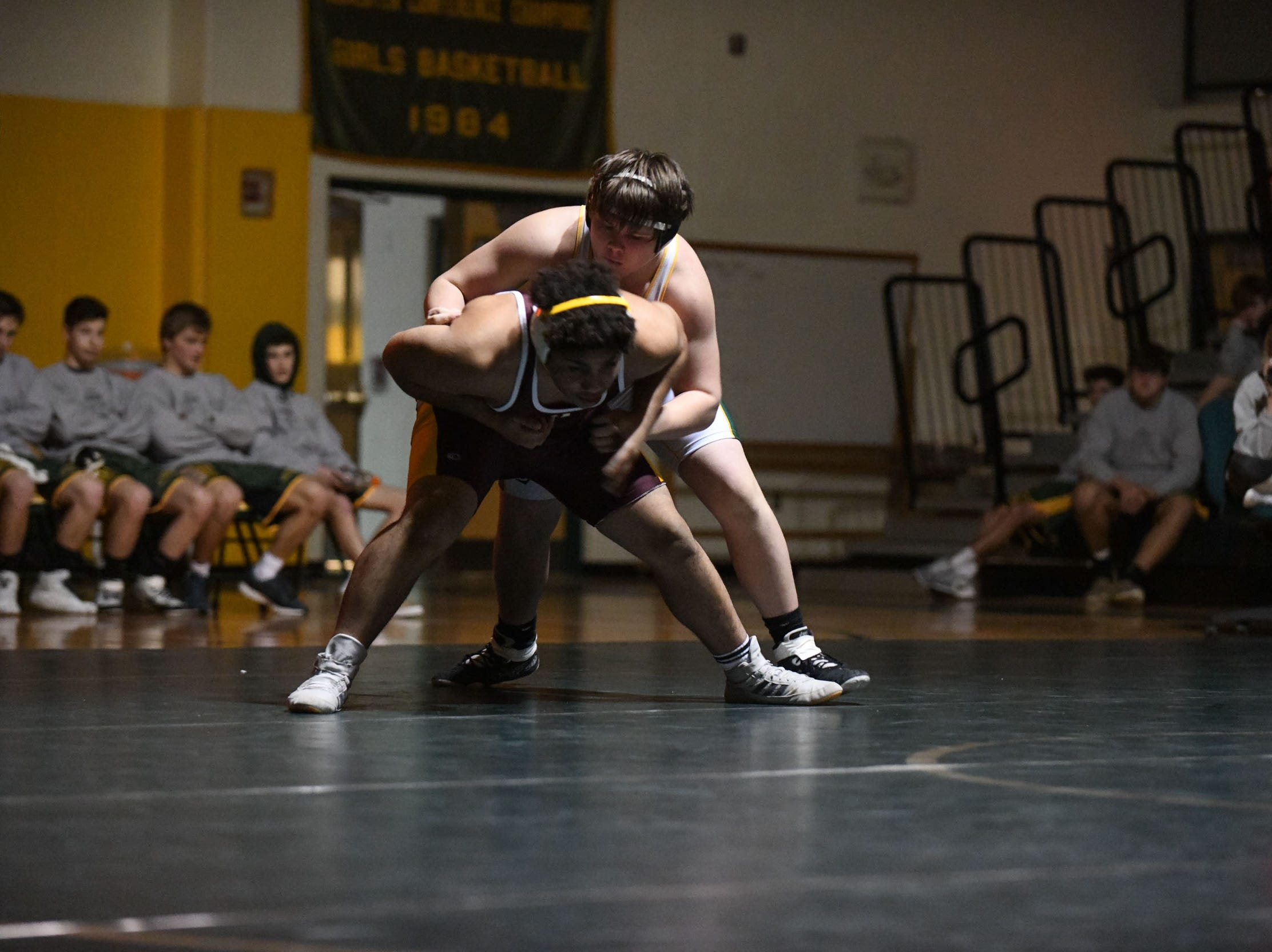 Indian River's TJ Burke battled Milford's Anthony Diaz the 220lb match on Thursday, Jan 17, 2019 in Dagsboro, Del. Milford won the match 53-15.