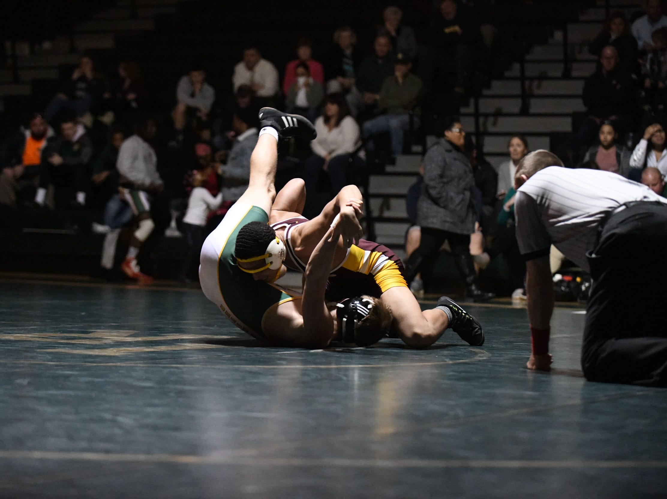 Indian River's Jalen Holland-Holloway battled Milford's Dalton Deevey during the 152lb match on Thursday, Jan 17, 2019 in Dagsboro, Del. Milford won the match 53-15.