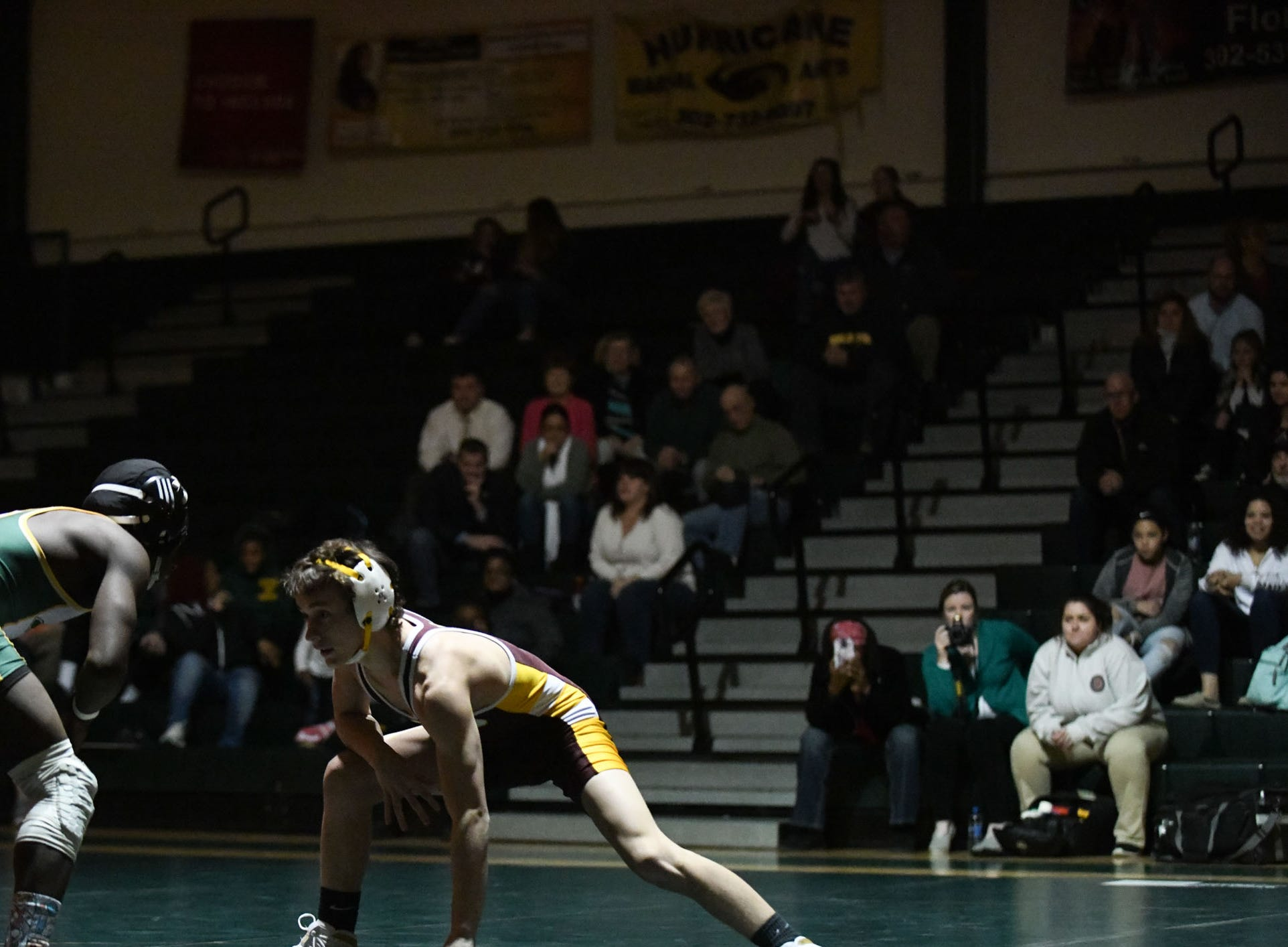 Indian River's William Rayne battled Milford's Trenton Grant during the 120lb match on Thursday, Jan 17, 2019 in Dagsboro, Del. Milford won the match 53-15.