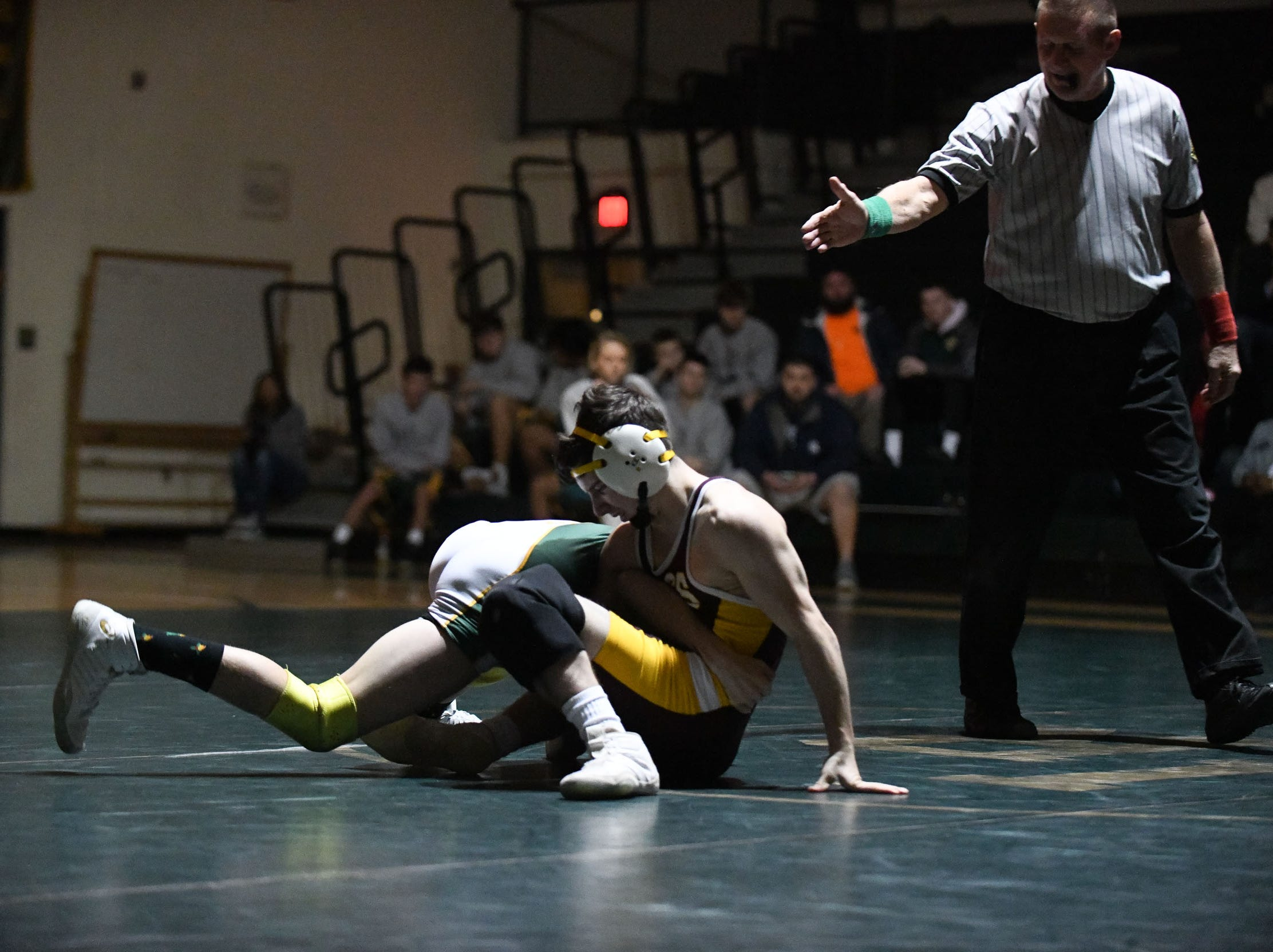 Indian River's Ian Shaubach battled Milford's Jack Thode during the 113lb match on Thursday, Jan 17, 2019 in Dagsboro, Del. Milford won the match 53-15.