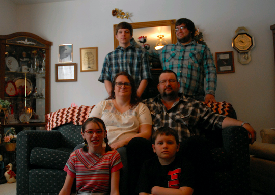 Charity Penning (center, left) and husband Jeff with their four children.