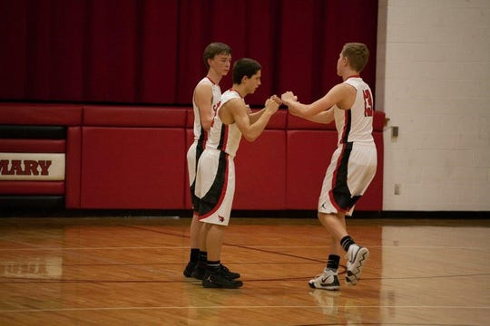 St. Mary players Cole Welbig (left), Connor Libis and Sam Palmer.