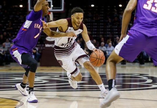 Jarred Dixon (11), of Missouri State, drives to the net during the Bears game against the Evansville Purple Aces at JQH Arena on Wednesday, Jan. 16, 2019.