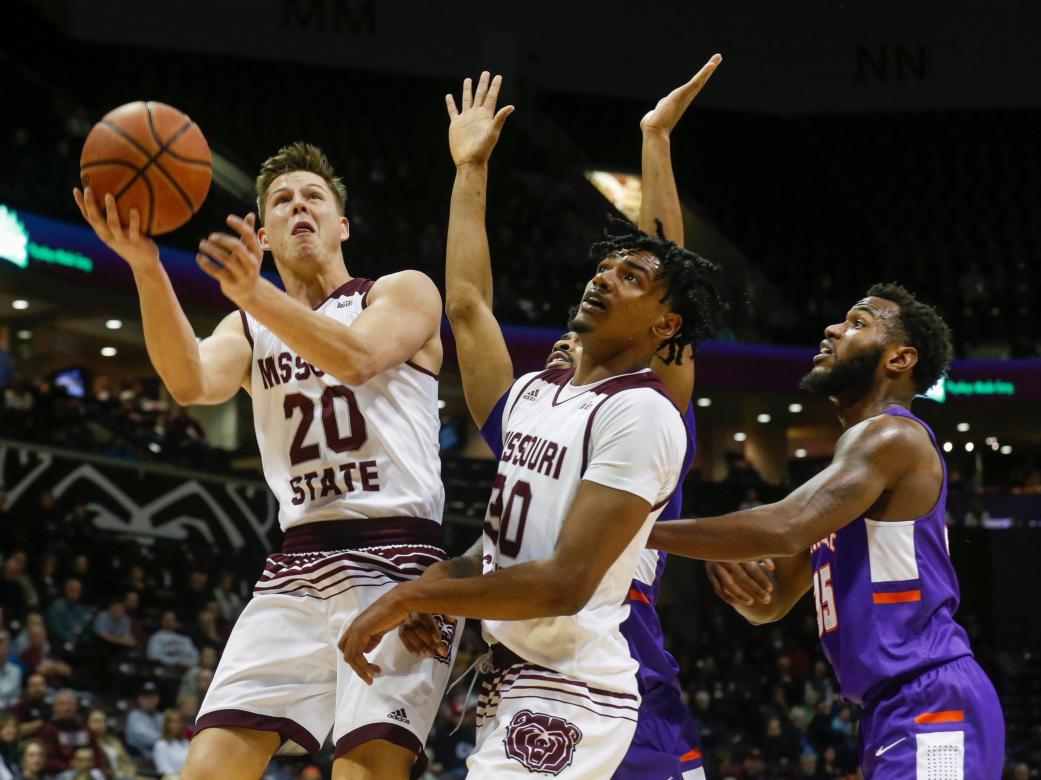 Ryan Kreklow (20), of Missouri State, puts up a shot during the Bears game against the Evansville Purple Aces at JQH Arena on Wednesday, Jan. 16, 2019.