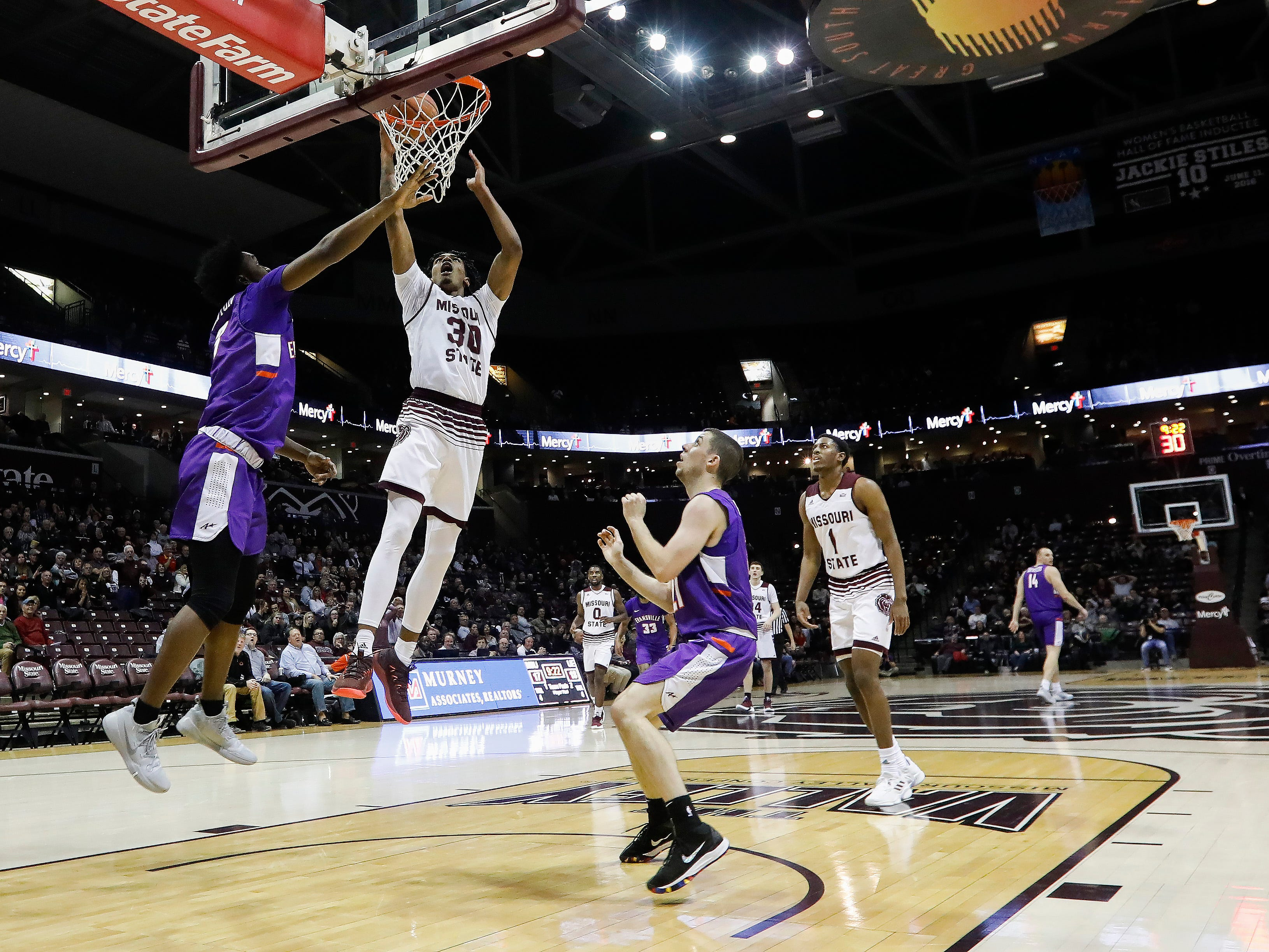 Tulio Da Silva (30), of Missouri State, dunks the ball during the Bears game against the Evansville Purple Aces at JQH Arena on Wednesday, Jan. 16, 2019.