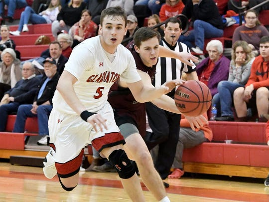 Riverheads' Zack Adams (#5) is moving the ball as Stuarts Draft's Mark Rodgers (#24) slips in to knock the ball away during a game played in Greenville on Wednesday, Jan. 16, 2019.