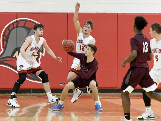 Stuarts Draft's Ryan Riley has the ball as he feels Riverheads' defensive pressure during a game played in Greenville on Wednesday, Jan. 16, 2019.