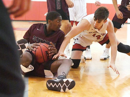 Stuarts Draft's Zakar Woodson has the ball after going down as Riverheads' Honor Robinson reaches for it during a game played in Greenville on Wednesday, Jan. 16, 2019.