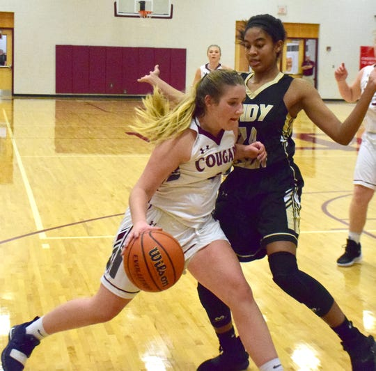 Stuarts Draft's McKinley Fitzgerald collides with Buffalo Gap's Amaya Lucas near the baseline  during the second half of their Shenandoah District girls basketball game on Wednesday, Jan. 16, 2019, at Stuarts Draft High School in Stuarts Draft , Va.