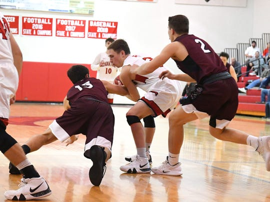 Stuarts Draft's Kasey Branch (#15) and Aaron Nice (#2) try to take the ball from a Riverheads' Josh Kinzel during a game played in Greenville on Wednesday, Jan. 16, 2019.