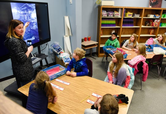 Teacher Deb Blum shows her students the damage to their classroom Tuesday, Jan. 15, at Pleasantview Elementary School in Sauk Rapids. Blum's class has moved to an area of the learning resource center.