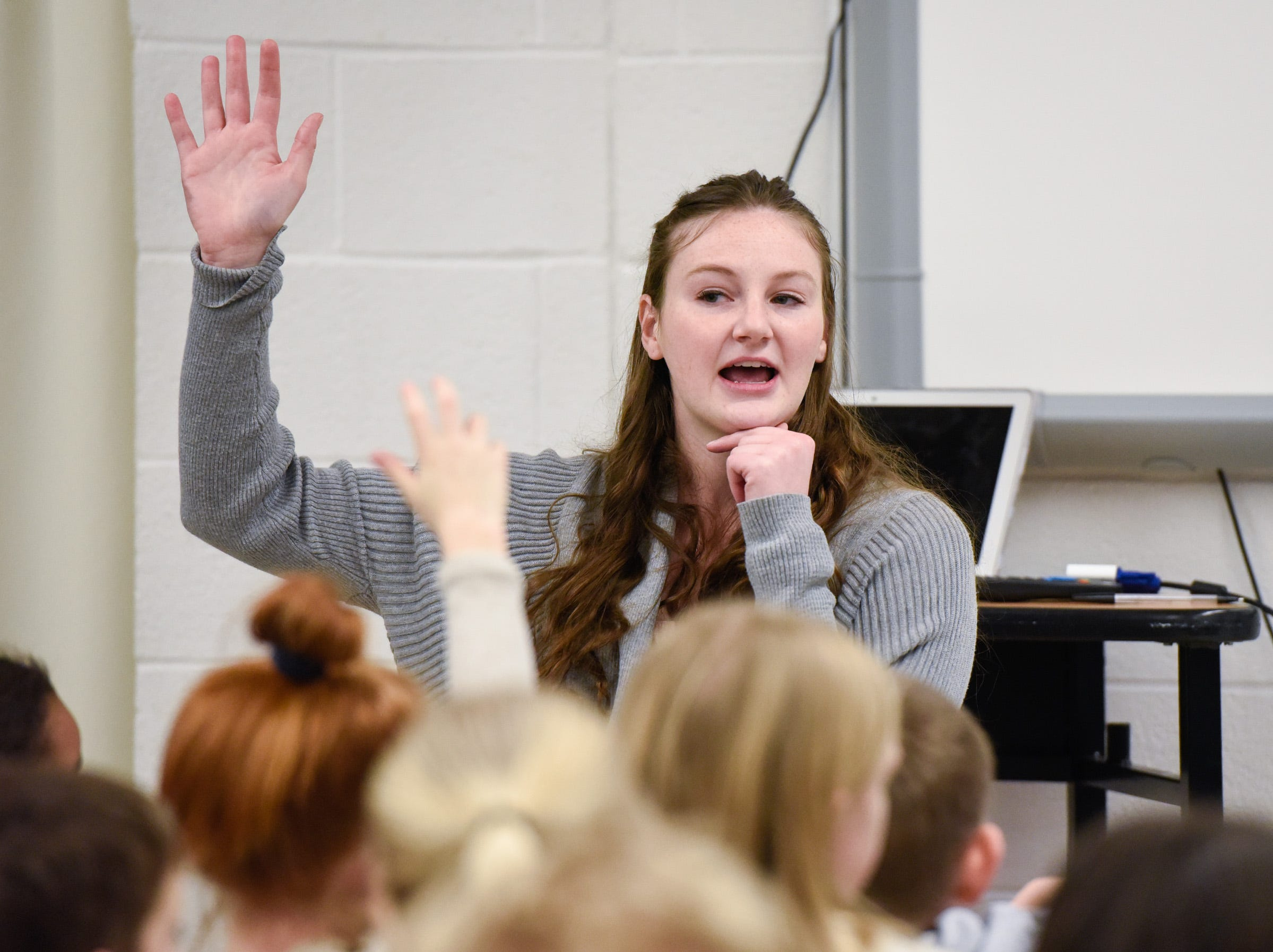 Teacher Emily Young answers students questions in their new classroom area Tuesday, Jan. 15, after a fire damaged classrooms at Pleasantview Elementary School in Sauk Rapids.